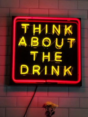 Noen sign - Think about the drink